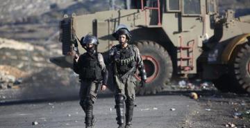 İsrail güçleri 22 Filistinliyi daha gözaltına aldı